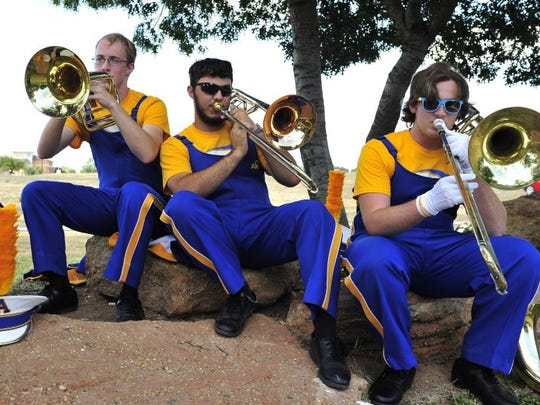 Standard-Times File photos Angelo State University Ram band members Brian Leary, Joseph Lynch and Anthony Wilson practice in the shade before performing during the season's first Ram Jam on Sept. 4 to kick off the 2015 football season.