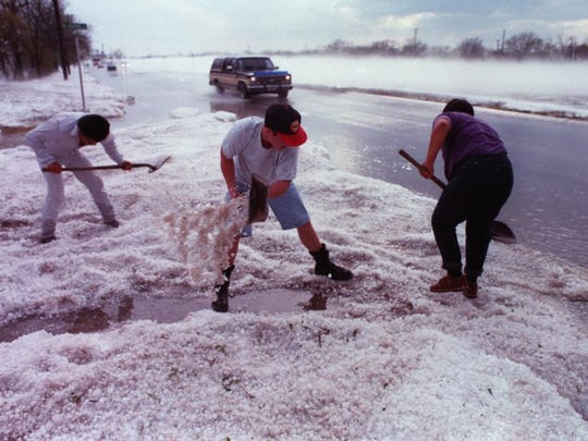Standard-Times file photos Three boys shovel hail that fell during the Memorial Day weekend storm of May 1995.