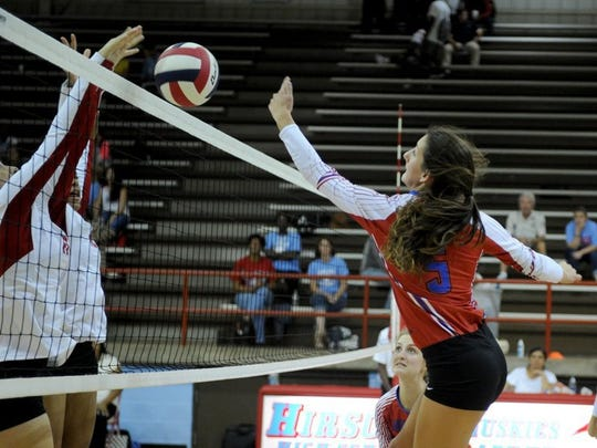 Graham's Jasmine Sims tries the reach the ball after it's blocked by Hirschi defenders Tuesday at Hirschi.