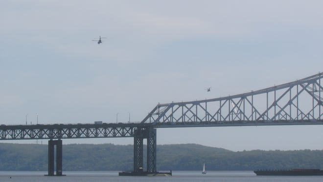 President Obama's advance team helicopters head back towards Manhattan by the Tappan Zee bridge.The team was checking the site of the former GM Site in advance of an upcoming presidential visit.