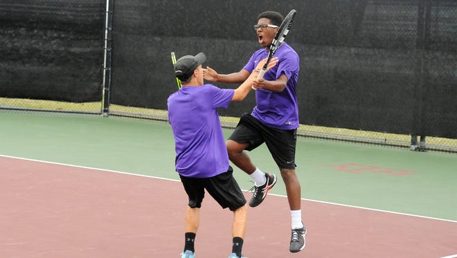 Wylie's Cason Byington, left, and Courtney Holmes celebrate their 4-6, 6-1, 10-6 win at No. 3 boys doubles against Fredericksburg in the Class 4A state finals on Thursday, Nov. 2, 2017 at the George P. Mitchell Tennis Center in College Station.