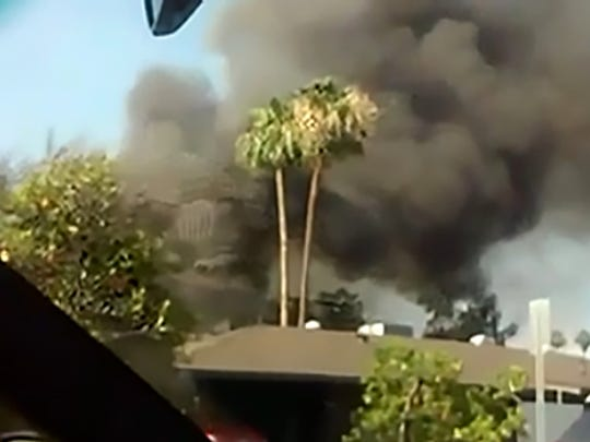 Smoke billowing from behind a Phoenix house Monday near Alice Avenue and Ocotillo Drive.