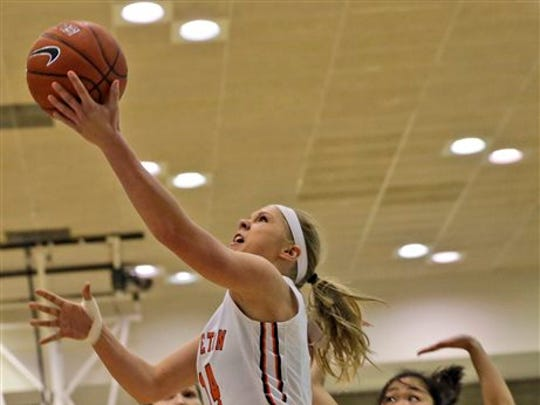 Guard Amanda Berntsen (14) of Chatham is one of only