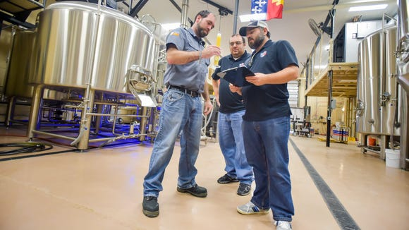 Cajun Brewing is Lafayette's first craft brewery and has recently ecpanded to more than 30 locations across Acadiana. Pictured- James Lutring,-Brewmaster, Barrett Bossley and Chad Lege'.