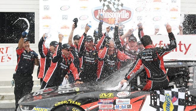 First-time NASCAR winner Jeremy Clements is showered by his crew in victory lane after the Johnsonville 180.