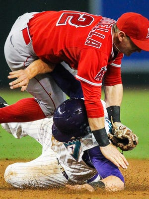 Arizona Diamondbacks shortstop Nick Ahmed collides with L.A. Angels second baseman Johnny Giavotella just after being forced out at second base. The Angels defeated the Diamondbacks 7-1 at Chase Field in Phoenix, AZ, on Thursday, June 18, 2015.
