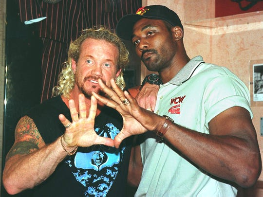 Diamond Dallas Page poses with former NBA great Karl Malone before they teamed up in 1998.