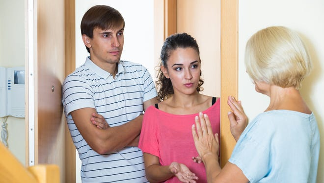 Neighbors coming to lady with complains.