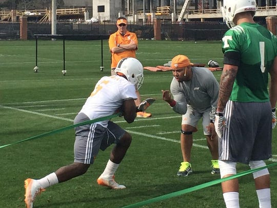 Jalen Hurd, right, watches as Alvin Kamara carries the ball toward running backs coach Robert Gillespie during a drill at a recent Tennessee spring practice.