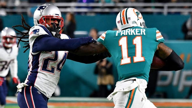 Patriots cornerback Stephon Gilmore, left, and Dolphins wide receiver DeVante Parker have had interesting matchups over the years.