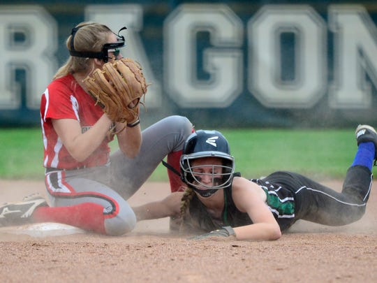 Oak Harbor catcher Maddy Rathbun threw out a runner out at second Thursday.