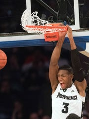 Friars guard Kris Dunn (3) dunks the ball in the second