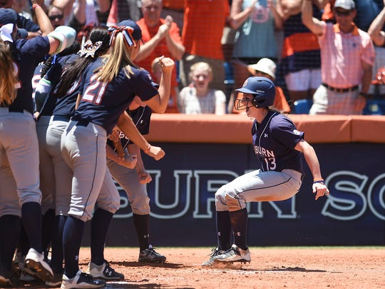 Auburn third baseman Kasey Cooper celebrates after her three-run home run against Louisiana-Lafayette.