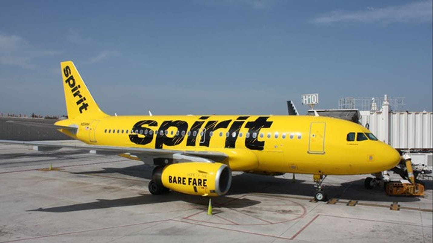 Spirit boots breast feeding woman from plane for Book a flight with spirit airlines