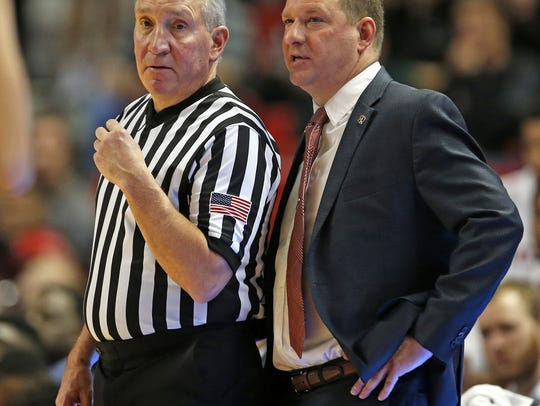 Texas Tech coach Chris Beard talks with a referee during