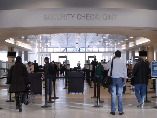 A line forms at the security checkpoint at the Greater