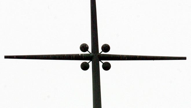 A bird darts from the steeple of the Church of the Visitation in Eaton, Ohio.