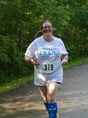 Andrea Bryant Canterbury running the 2016 Comeback Trail 5K at Glenwood Gardens.