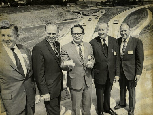 Officials celebrate the 1970 opening of the portion