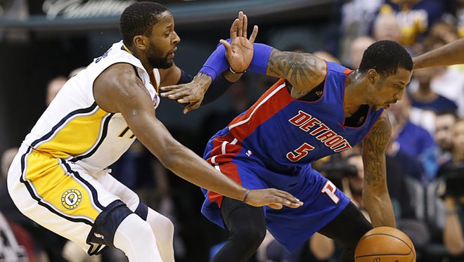 Indiana Pacers forward C.J. Miles (0) plays tight defense on Detroit Pistons guard Kentavious Caldwell-Pope (5) at Bankers Life Fieldhouse on Jan. 2, 2016.