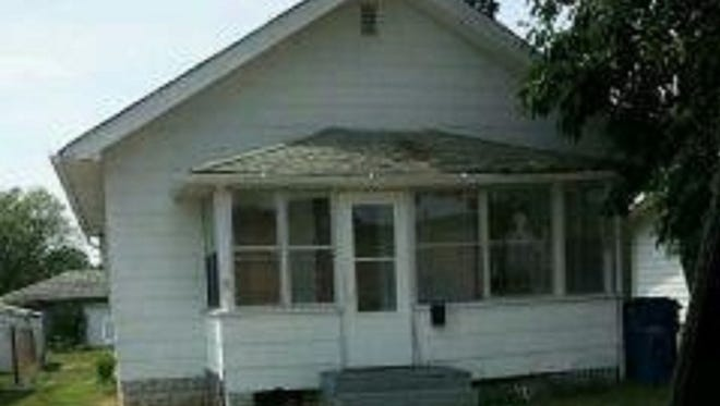 The Carolina Street Demon House in Gary, Ind., was said to be haunted by more than 200 demons.  Carolina Street in Gary. Officials say the home was unoccupied at the time the photo was taken.