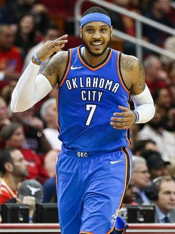 Oklahoma City Thunder forward Carmelo Anthony celebrates