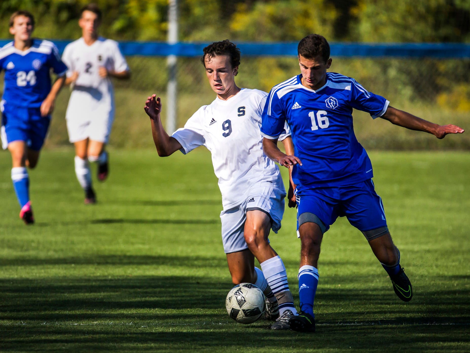 Salesianum's James Strine (No. 9) fights for position on the ball with Wilmington Charter's Andrew Amato (No. 16) in the first half of Salesianum's 1-0 win over Wilmington Charter at the Hockessin Soccer Club in Hockessin on Thursday afternoon.