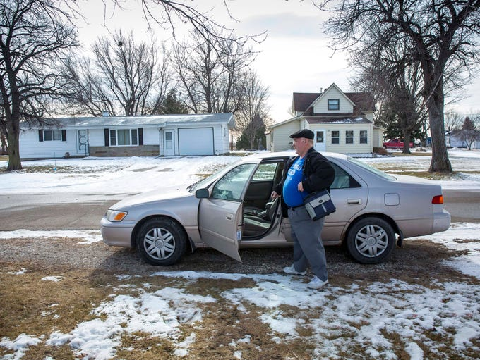 Dean Lamp, of Glidden, Iowa, leaves for work Friday,