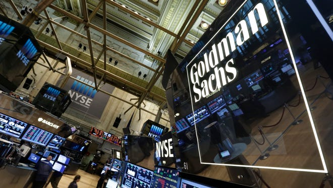 A lighted sign marks the Goldman Sachs trading post on the floor of the New York Stock Exchange, Tuesday, Aug. 5, 2014.