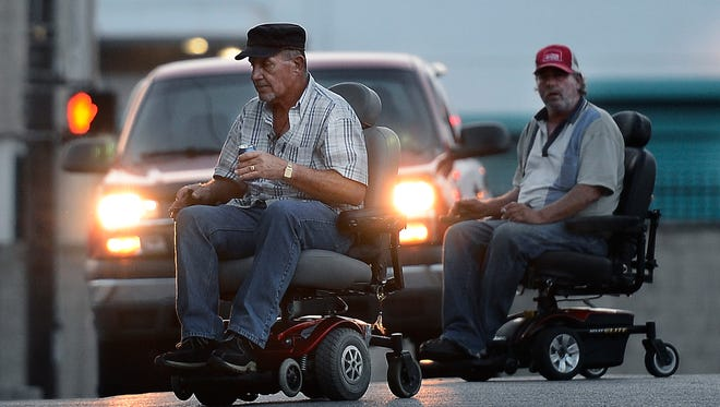 Robert Michael Conner, wearing the red cap, crosses Berkley Drive near Gallatin Pike on Oct. 14, 2013, in Madison, Tenn. Conner died at the same intersection Saturday night when he was struck by a vehicle while attempting to cross Gallatin Pike.