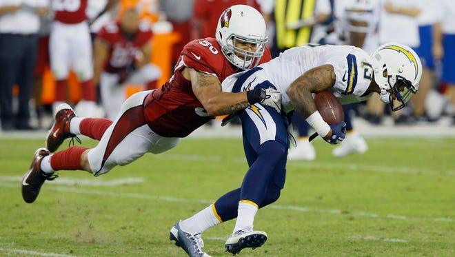 Arizona Cardinals inside linebacker Larry Foote (50) brings down San Diego Chargers wide receiver Keenan Allen (13) after a reception during the fourth quarter of their  NFL Monday Night Football game, Monday, Sept. 8, 2014, in Glendale, Ariz The Cardinals won 18-17.