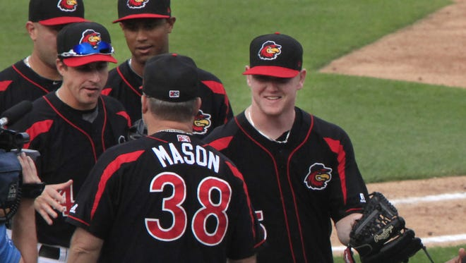 Rochester Red Wings Marty Mason congratulates pitcher Logan Darnell Monday night.