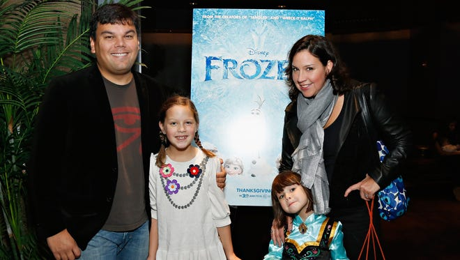 Actor/writer/ composer Robert Lopez, left, and writer/ lyricist Kristen Anderson-Lopez, right, and their children (who provided voices in the film) attend The Cinema Society's special screening of 'Frozen' in New York City.