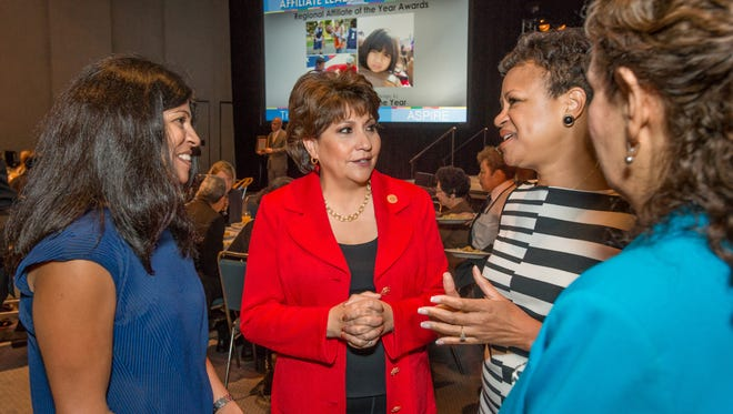 National Council of La Raza President Janet Murguia, center, is working to get Latino voters to turn out in 2014.