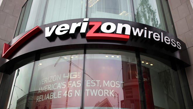 A sign is posted in front of a Verizon Wireless store on January 24, 2012 in San Francisco, Calif.