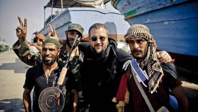 Shane Smith with rebel fighters in Benghazi, Libya, after disembarking the fishing vessel Thaleel, that sailed between Misrata and Benghazi.