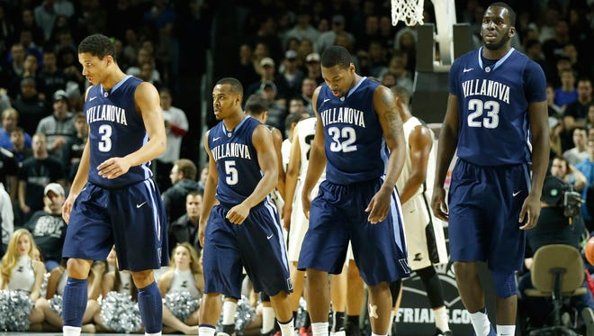 Villanova Wildcats walk to the bench during a break in the action against the Providence Friars in the first half at Dunkin Donuts Center.