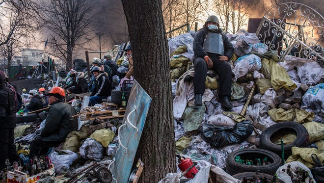 Anti-government protesters guard barricades near Independence Square on Friday in Kiev, Ukraine.