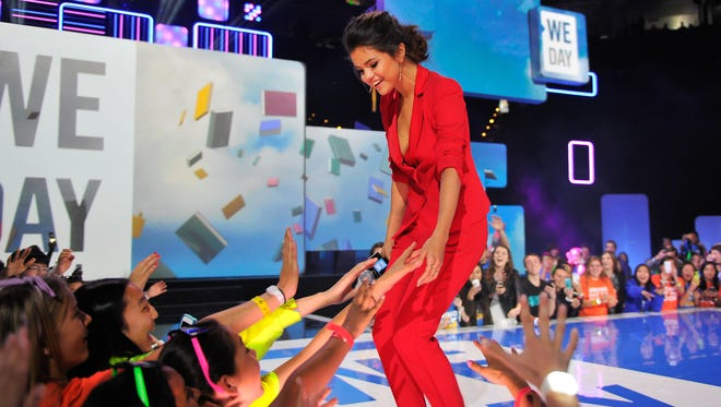 Selena Gomez in Oakland, Calif.,speaks about youth empowerment to 16,000 students and educators at the We Day California event at Oracle Arena on March 26, 2014.