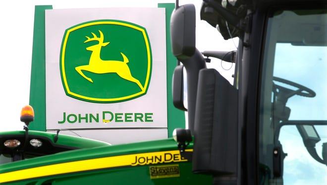 John Deere farming equipment at a dealership in Petersburg, Ill.