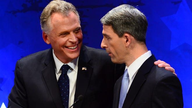 Virginia gubernatorial candidate Democrat Terry McAuliffe, left, shakes hands with Republican candidate Attorney General Ken Cuccinelli at the end of the Fairfax County Chamber of Commerce debate Wednesday, Sept. 25, 2013, in McLean, Va.