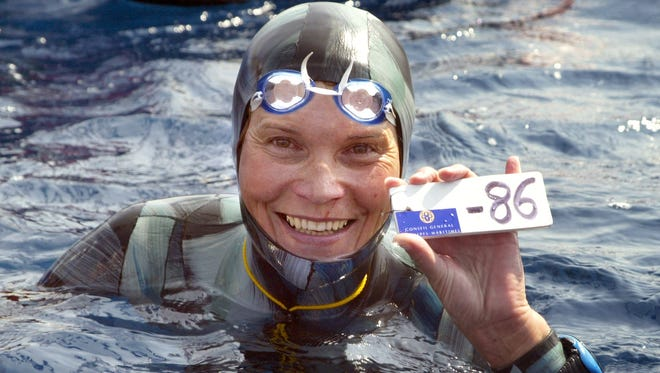 A photo taken on September 3, 2005, shows Russian Natalia Molchanova holding the minus 86 metres tag that gives her a win in the first women's free-diving world championship in Villefranche-sur-Mer. Molchanova, 53, has been reported missing since August 2, 2015 following a fun dive off the coast of Formentera.