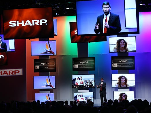 LAS VEGAS, NV - JANUARY 06:  Sharp senior vice president of marketing Jim Sanduski talks about the new line of the Sharp Aquos televisions during a press event at the Mandalay Bay Convention Center for the 2014 International CES on January 6, 2014 in Las Vegas, Nevada. CES, the world's largest annual consumer technology trade show, runs from January 7-10 and is expected to feature 3,200 exhibitors showing off their latest products and services to about 150,000 attendees.  (Photo by Justin Sullivan/Getty Images)