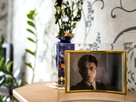 "A photo of Aleksandr ""Sasha"" Panin is displayed in his grandmother's house in Tver, Russia. Working from a Moscow apartment, he developed ""SpyEye,"" one of the most destructive computer software programs ever launched in the Internet's criminal underworld."