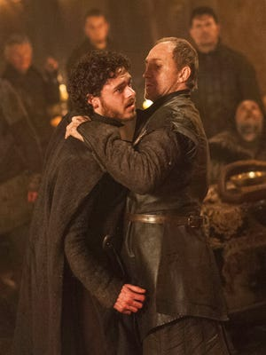 """Richard Madden and Michael McElhatton in the infamous """"Red Wedding"""" scene from """"Game of Thrones."""""""