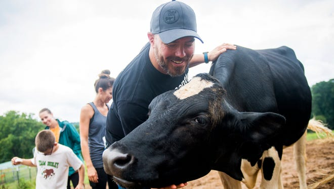 Chris Peed gives chin scratches to Captain at The Gentle Barn in Knoxville on Sunday, July 22, 2018. The animal sanctuary held its last tour at its Knoxville farm before the farm moves to its new home in Nashville.