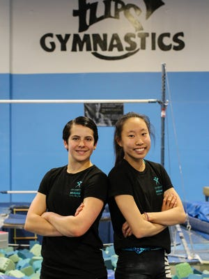 Gymnasts Alexia Burch, left, and Julie Ro have qualified to compete in the Junior Olympic National Championships.