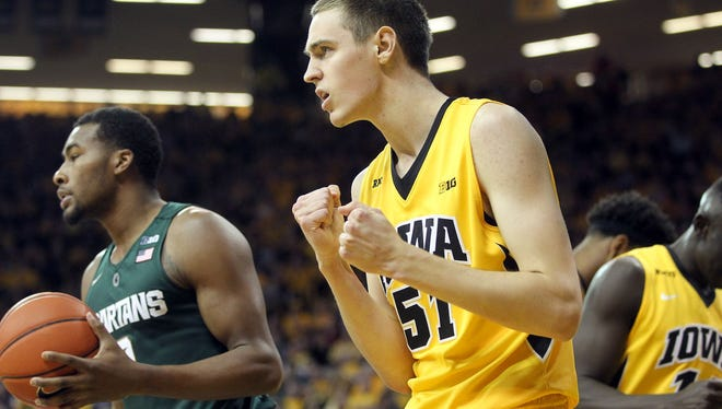 Iowa's Nick Baer celebrates after drawing a foul during the Hawkeyes' 83-70 win over MSU on Dec. 29 at Carver-Hawkeye Arena in Iowa City, Iowa.