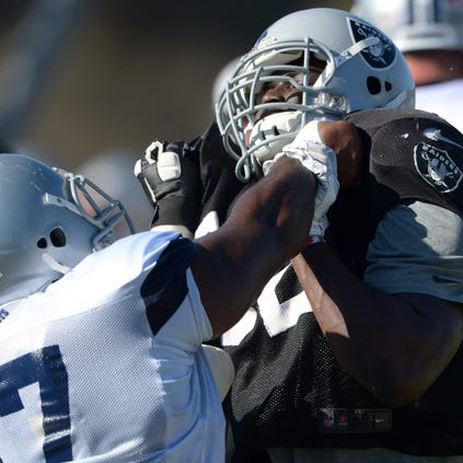 Dallas Cowboys guard Ronald Patrick (67) defends against Oakland Raiders defensive tackle Stacy McGee (92) at scrimmage at River Ridge Fields