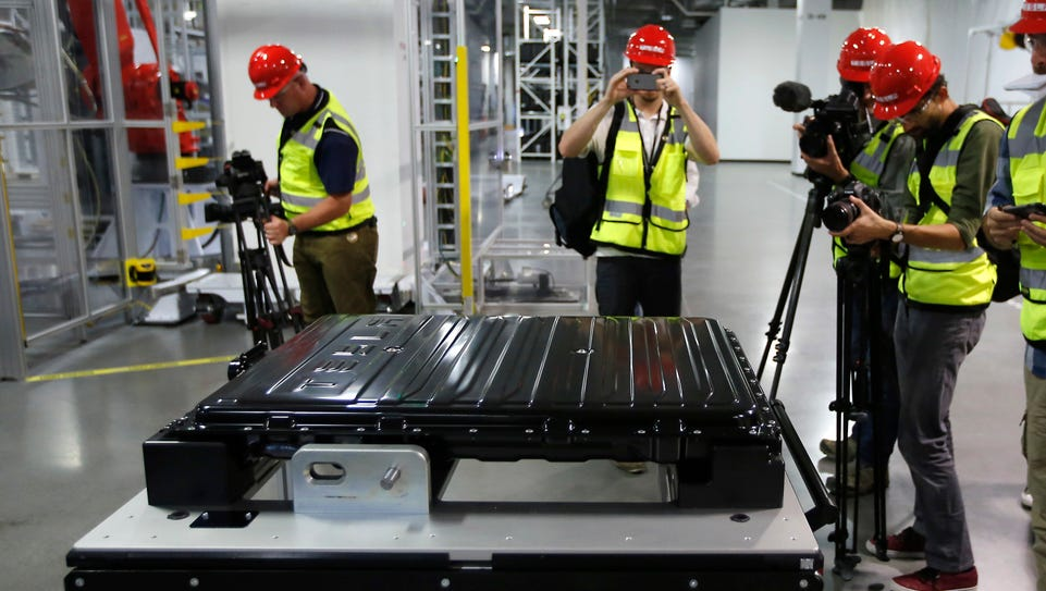 A Tesla battery pack is displayed during a media tour